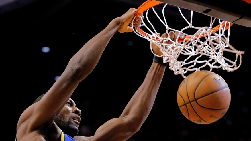 Golden State Warriors' Festus Ezeli, of Nigeria, dunks against the Phoenix Suns during the first half of an NBA basketball game on Friday, April 5, 2013, in Phoenix. (AP Photo/Matt York)