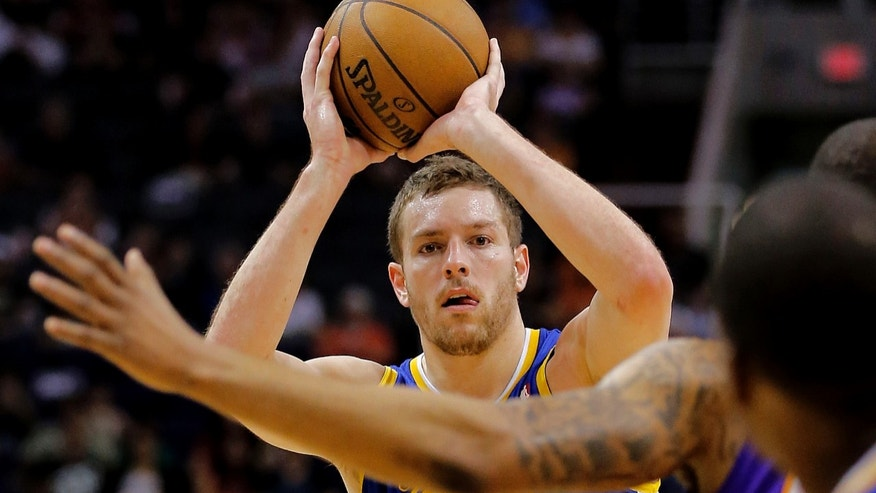 Golden State Warriors' David Lee looks to pass against the Phoenix Suns during the first half of an NBA basketball game on Friday, April 5, 2013, in Phoenix. (AP Photo/Matt York)