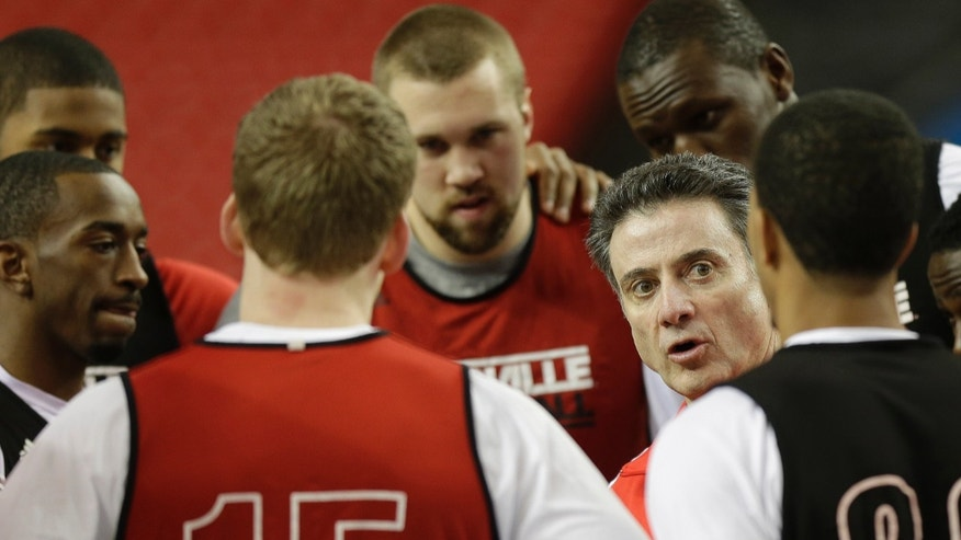 Louisville head coach Rick Pitino speaks to his players during practice for their NCAA Final Four tournament college basketball semifinal game against Wichita State, Friday, April 5, 2013, in Atlanta. Louisville plays Wichita State in a semifinal game on Saturday. (AP Photo/John Bazemore)
