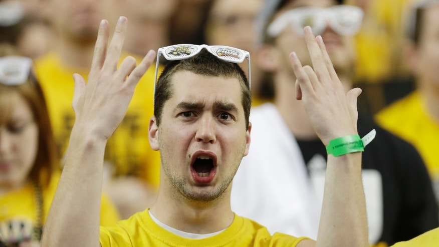 A Wichita State fan cheers before the first half of the NCAA Final Four tournament college basketball semifinal game between Louisville and Wichita State, Saturday, April 6, 2013, in Atlanta. (AP Photo/Charlie Neibergall)