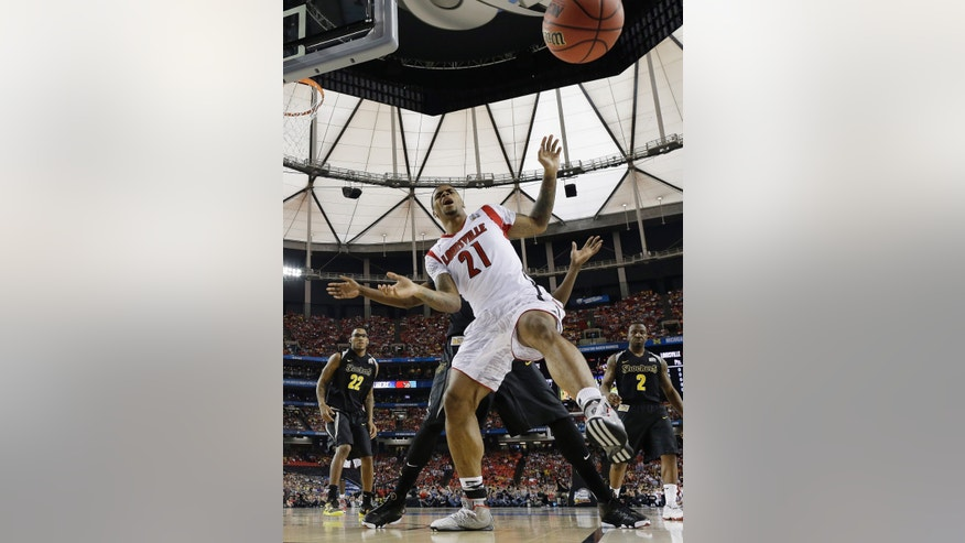 Louisville's Chane Behanan loses the ball against Wichita State during the first half of the NCAA Final Four tournament college basketball semifinal game Sunday, April 7, 2013, in Atlanta. (AP Photo/Charlie Neibergall)