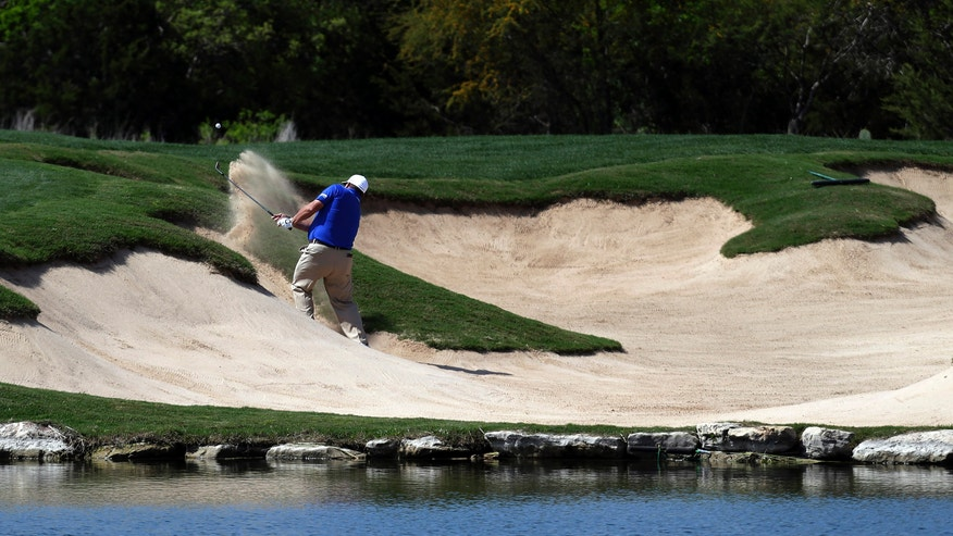 Jason Gore hits from a bunker on the third hole during the third round of the Texas Open golf tournament, Saturday, April 6, 2013, in San Antonio.  (AP Photo/Eric Gay)