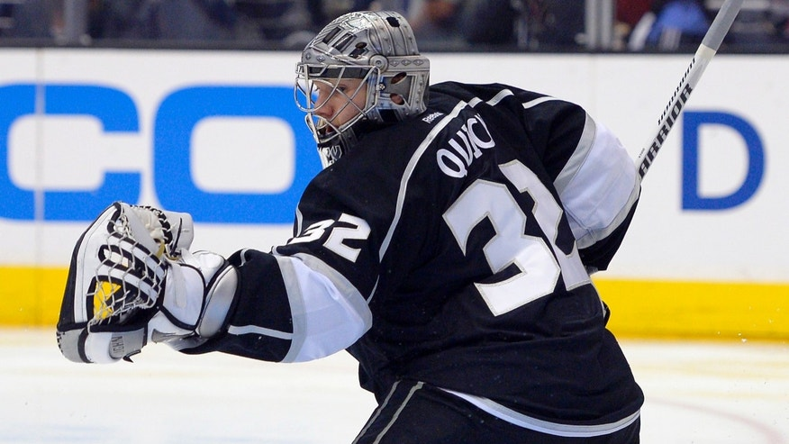 Los Angeles Kings goalie Jonathan Quick makes a glove save during the first period of their NHL hockey game against the Edmonton Oilers, Saturday, April 6, 2013, in Los Angeles. (AP Photo/Mark J. Terrill)