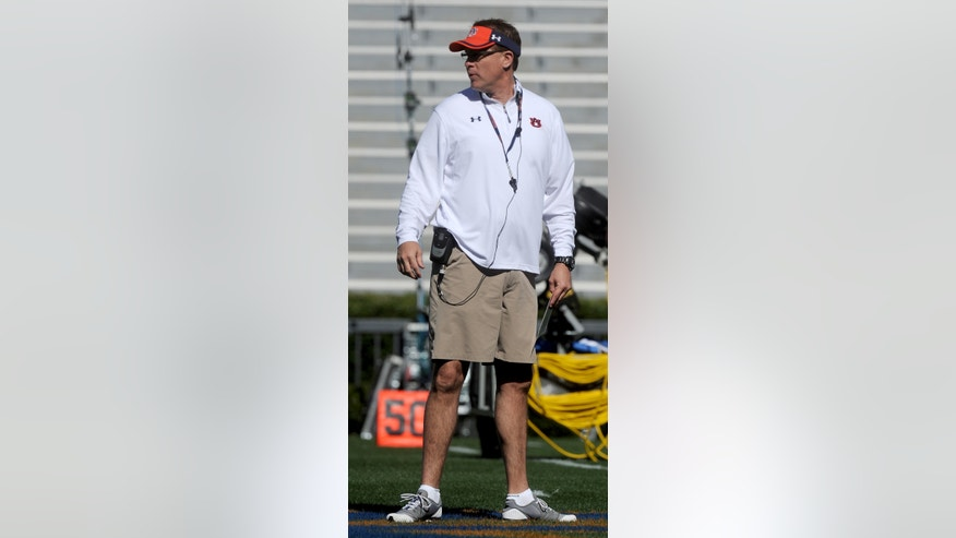 Auburn head coach Gus Malzahn watches his team during spring NCAA college football practice Saturday, April 6, 2013, at Jordan-Hare Stadium in Auburn, Ala. (AP Photo/AL.com, Julie Bennett) MAGS OUT