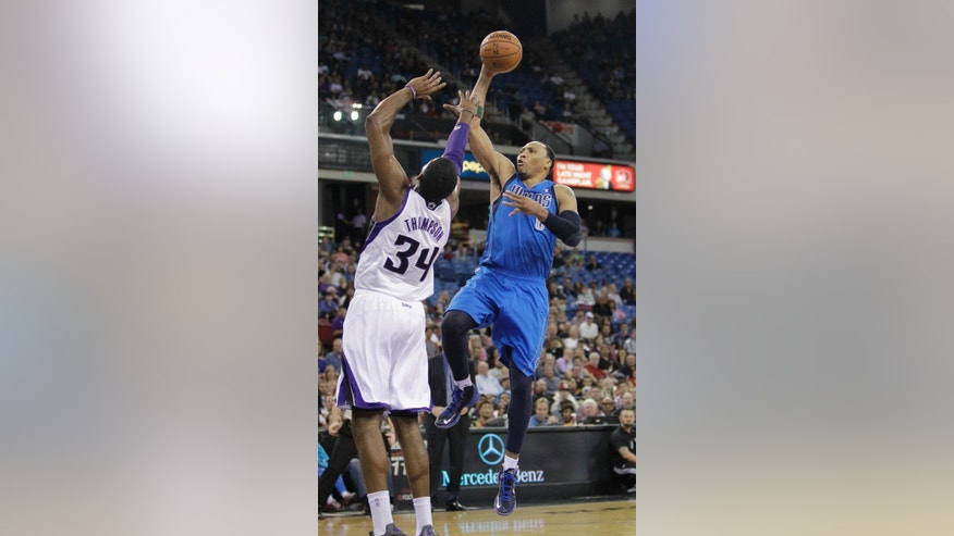 Dallas Mavericks forward Shawn Marion, right, shoots over Sacramento Kings forward Jason Thompson during the first quarter of an NBA basketball game in Sacramento, Calif., Friday, April 5, 2013. (AP Photo/Rich Pedroncelli)
