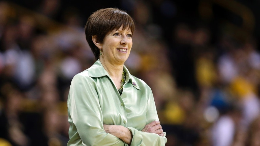 FILE - In this March 26, 2013, file photo, Notre Dame head coach Muffet McGraw looks on during the second half of a second-round game against Iowa in the women's NCAA college basketball tournament in Iowa City, Iowa. McGraw was selected as The Associated Press' women's basketball coach of the year on Saturday, April 6, 2013. (AP Photo/Charlie Neibergall, File)