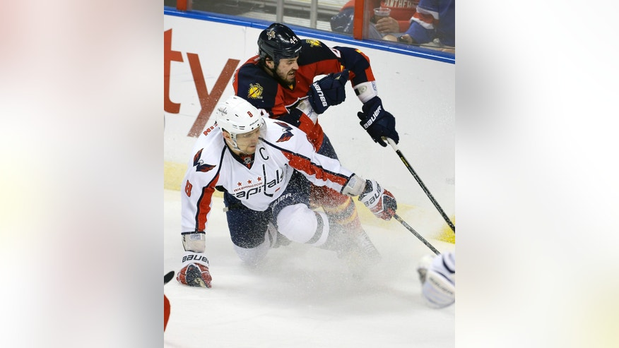 Washington Capitals' Alex Ovechkin (8) and Florida Panthers' Erik Gudbranson (44) battle for the puck during the first period of an NHL hockey game in Sunrise, Fla., Saturday, April 6, 2013. (AP Photo/J Pat Carter)