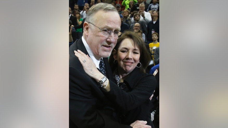 Minnesota Timberwolves head coach Rick Adelman, left, gets a hug from his wife Mary Kay after becoming the eighth coach in the NBA to win 1,000th games after the Timberwolves' 107-101 win over the Detroit Pistons in a basketball game, Saturday, April 6, 2013, in Minneapolis. (AP Photo/Jim Mone)