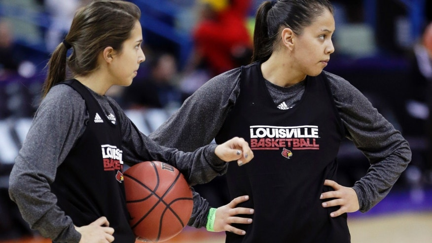 Louisville's Jude Schimmel, left, and her sister Shoni Schimmel warm up during practice at the Women's Final Four of the NCAA college basketball tournament, Saturday, April 6, 2013, in New Orleans. Louisville plays California in a semifinal game on Sunday. (AP Photo/Gerald Herbert)