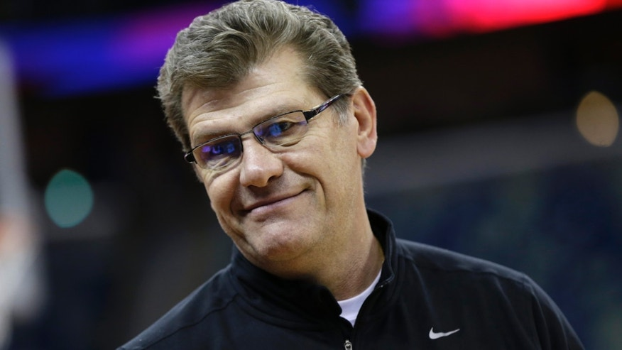 Connecticut head coach Geno Auriemma smiles during practice at the Women's Final Four of the NCAA college basketball tournament, Saturday, April 6, 2013, in New Orleans.  UConn plays Notre Dame in a semifinal game on Sunday. (AP Photo/Dave Martin)