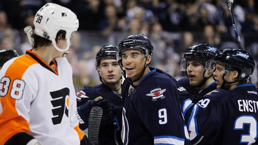 Winnipeg Jets forward Evander Kane (9) taunts Philadelphia Flyers defenseman Oliver Lauridsen after scoring during the second period of an NHL hockey game in Winnipeg on Saturday, April 6, 2013. (AP Photo/The Canadian Press, John Woods)