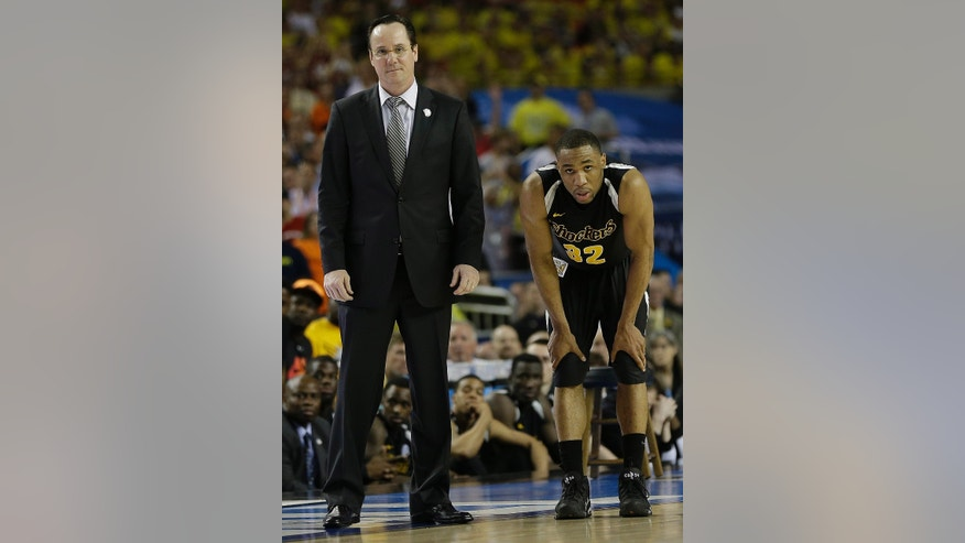 Wichita State head coach Gregg Marshall and Wichita State's Tekele Cotton watch play against Louisville during the second half of the NCAA Final Four tournament college basketball semifinal game Saturday, April 6, 2013, in Atlanta. Louisville won 72-68. (AP Photo/David J. Phillip)