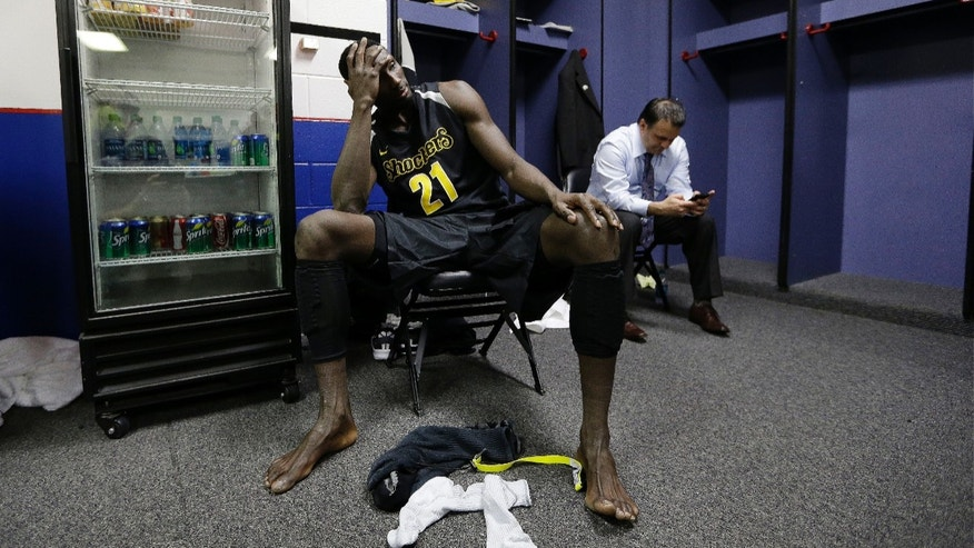 Wichita State's Ehimen Orukpe sits in the locker room after the first half of the NCAA Final Four tournament college basketball semifinal game against Louisville Saturday, April 6, 2013, in Atlanta. Louisville won 72-68. (AP Photo/John Bazemore)