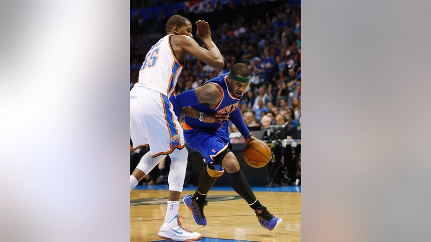 New York Knicks forward Carmelo Anthony, right,drives around Oklahoma City Thunder forward Kevin Durant (35) in the second quarter of an NBA basketball game in Oklahoma City, Sunday, April 7, 2013. (AP Photo/Sue Ogrocki)