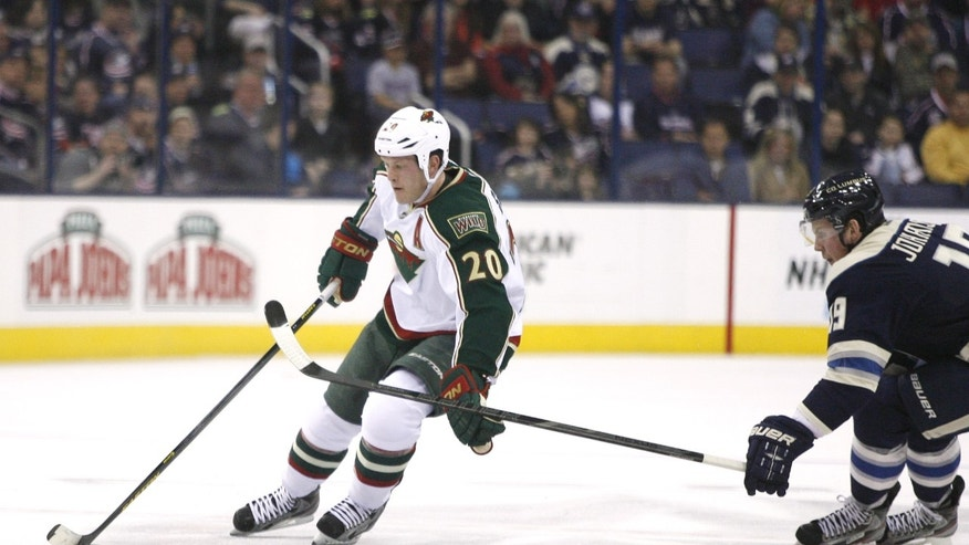 Minnesota Wild's Ryan Suter (20) brushes away the stick of Columbus Blue Jackets' Ryan Johansen (19) in the first period of an NHL hockey game on Sunday, April 7, 2013, in Columbus, Ohio. (AP Photo/Mike Munden)