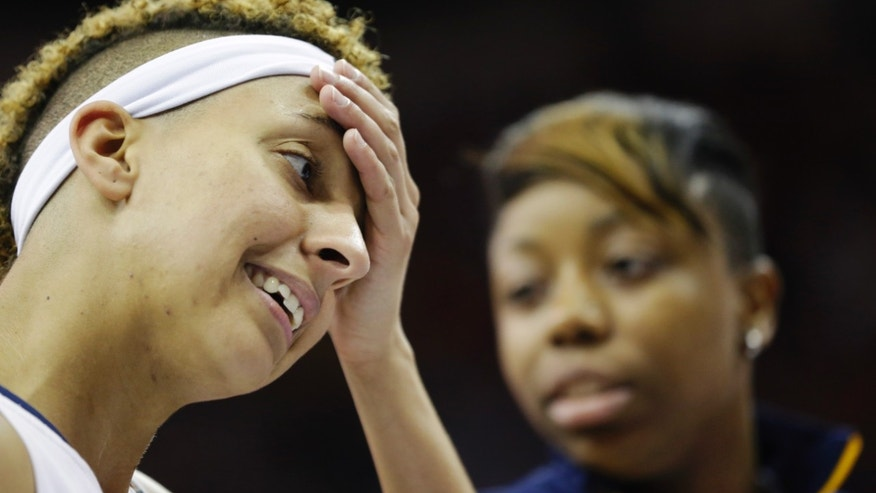 California guard Layshia Clarendon reacts after losing to Louisville at a national semifinal against California at the Women's Final Four of the NCAA college basketball tournament, Sunday, April 7, 2013, in New Orleans. Louisville won 64-57. At right is California guard Tierra Rogers. (AP Photo/Gerald Herbert)
