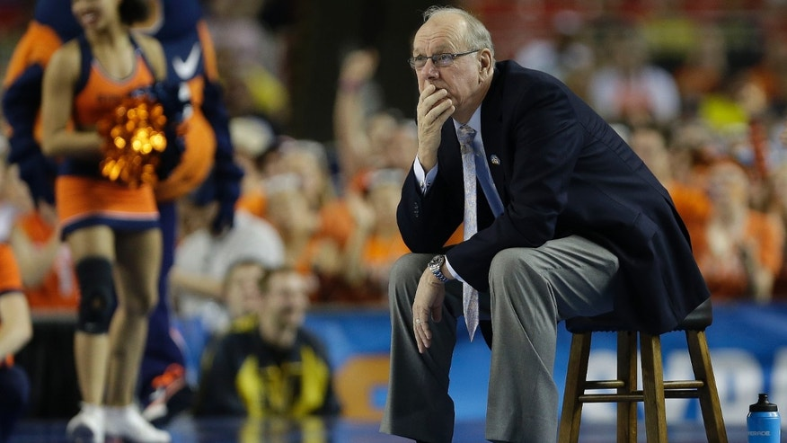 Syracuse head coach Jim Boeheim watches play against Michigan during the second half of the NCAA Final Four tournament college basketball semifinal game Saturday, April 6, 2013, in Atlanta. (AP Photo/Charlie Neibergall)