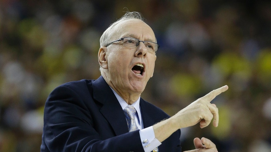Syracuse head coach Jim Boeheim speaks to players against Michigan during the first half of the NCAA Final Four tournament college basketball semifinal game Saturday, April 6, 2013, in Atlanta. (AP Photo/David J. Phillip)