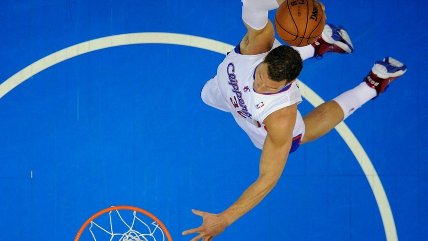 Los Angeles Clippers forward Blake Griffin dunks during the first half of their NBA basketball game against the Los Angeles Lakers, Sunday, April 7, 2013, in Los Angeles. (AP Photo/Mark J. Terrill)