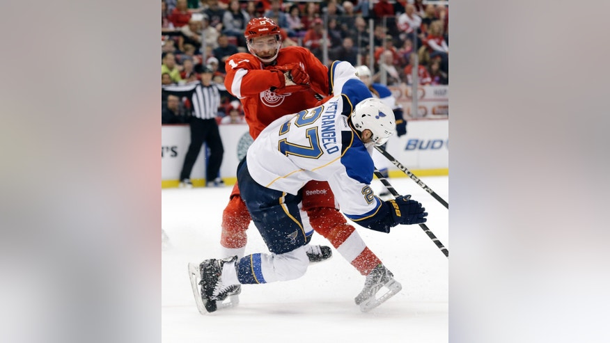 Detroit Red Wings center Pavel Datsyuk (13), of Russia, checks St. Louis Blues defenseman Alex Pietrangelo (27) in the second period of an NHL hockey game in Detroit, Sunday April 7, 2013. (AP Photo/Paul Sancya)