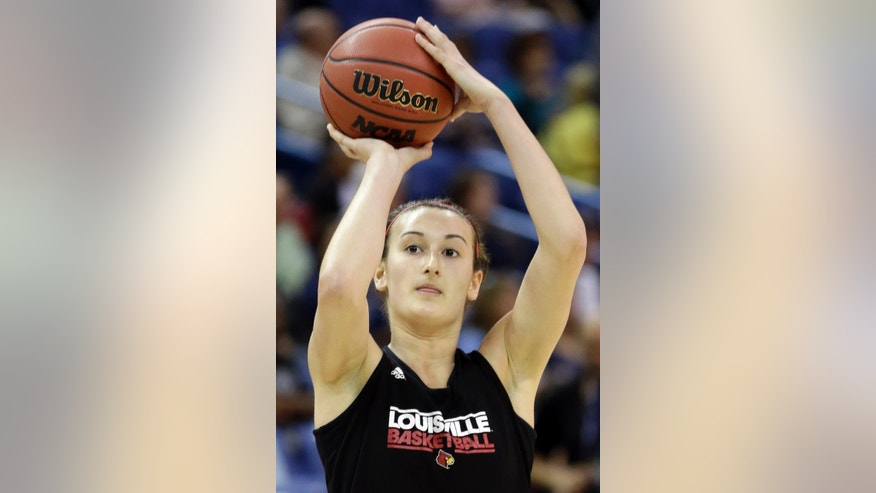Louisville guard Megan Deines shoots during practice at the Women's Final Four of the NCAA college basketball tournament, Saturday, April 6, 2013, in New Orleans. Louisville plays California in a national semifinal on Sunday. (AP Photo/Gerald Herbert)