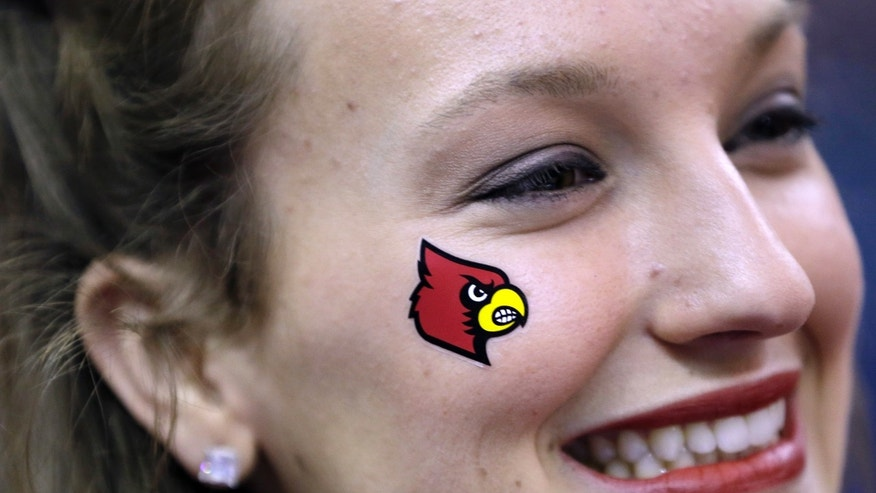 Louisville cheerleader Ailee Hanle shows off a temporary tattoo Cardinal on her cheek during practice at the Women's Final Four of the NCAA college basketball tournament, Saturday, April 6, 2013, in New Orleans. Louisville plays California in a semifinal game on Sunday. (AP Photo/Gerald Herbert)