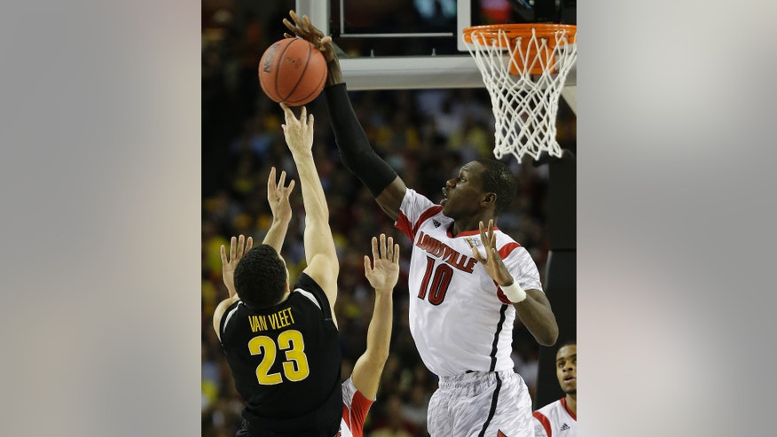 Louisville's Gorgui Dieng shoots over Wichita State's Fred Van Vleet during the second half of the NCAA Final Four tournament college basketball semifinal game Saturday, April 6, 2013, in Atlanta. (AP Photo/David J. Phillip)