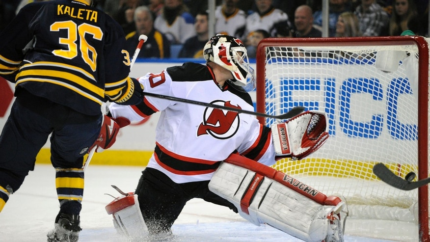 Buffalo Sabres right winger Patrick Kaleta (36) redirects the puck past New Jersey Devils goaltender Martin Brodeur (30) for a goal during the first period of an NHL hockey game in Buffalo, N.Y., Sunday, April 7, 2013. (AP Photo/Gary Wiepert)