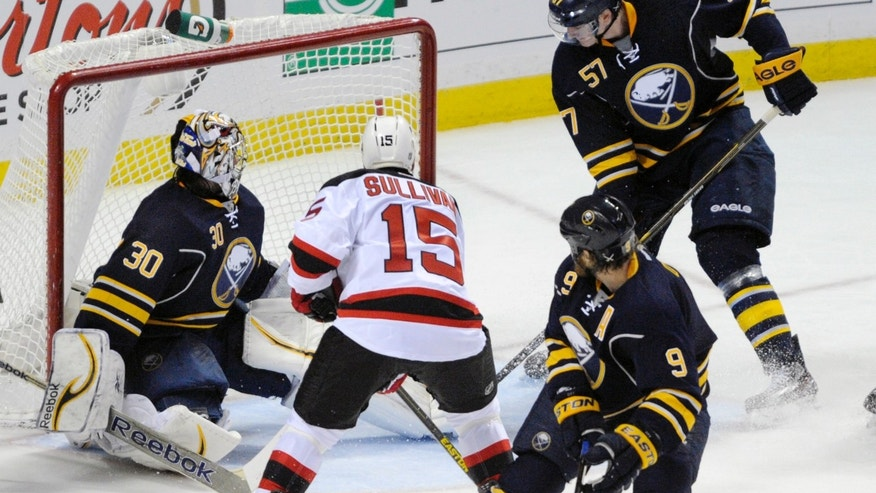New Jersey Devils left winger Steve Sullivan (15) scores against Buffalo Sabres goaltender Ryan Miller (30), center Steve Ott (9) and defenseman Tyler Myers (57) during the first period of an NHL hockey game in Buffalo, N.Y., Sunday, April 7, 2013. (AP Photo/Gary Wiepert)