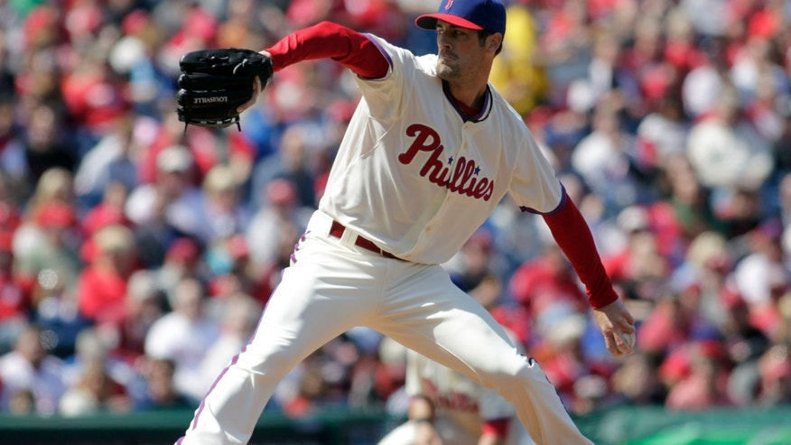 Philadelphia Phillies starting pitcher Cole Hamels throws against the Kansas City Royals in the first inning of a baseball game on Sunday, April, 7, 2013, in Philadelphia. (AP Photo/H. Rumph Jr)