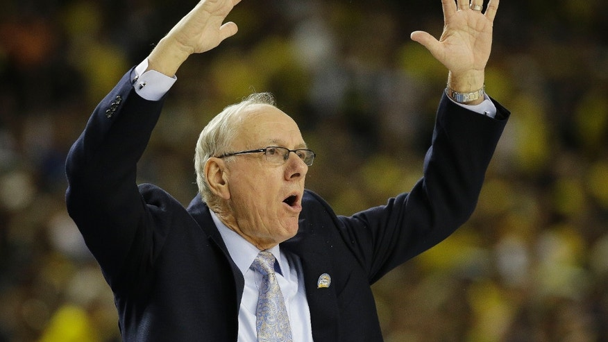 Syracuse head coach Jim Boeheim reacts to play against Michigan during the first half of the NCAA Final Four tournament college basketball semifinal game Saturday, April 6, 2013, in Atlanta.  (AP Photo/David J. Phillip)