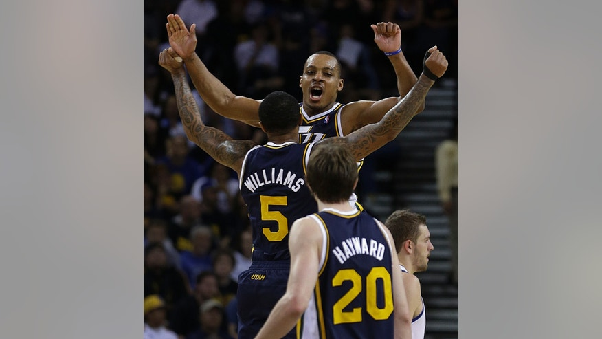 Utah Jazz' Mo Williams (5) and Randy Foye celebrate during the final seconds of an NBA basketball game against the Golden State Warriors Sunday, April 7, 2013, in Oakland, Calif. (AP Photo/Ben Margot)