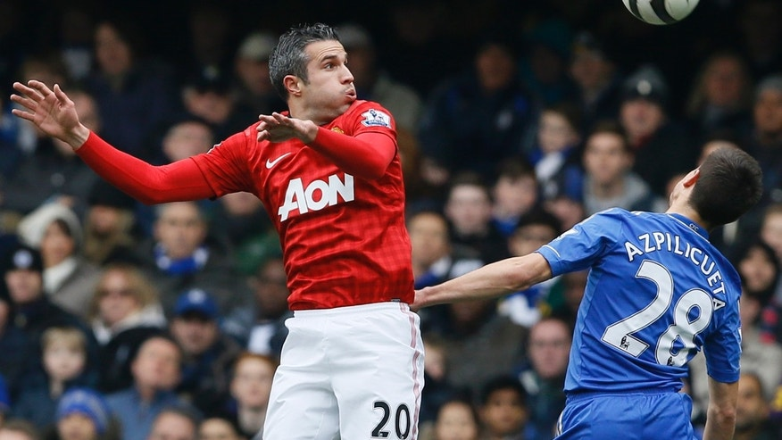 Chelsea's Cesar Azpilicueta, right, vies for the ball with Manchester United's Robin van Persie during the English FA Cup quarterfinal replay soccer match between Chelsea and Manchester United at Stamford Bridge Stadium in London, Monday, April 1, 2013. (AP Photo/Kirsty Wigglesworth)