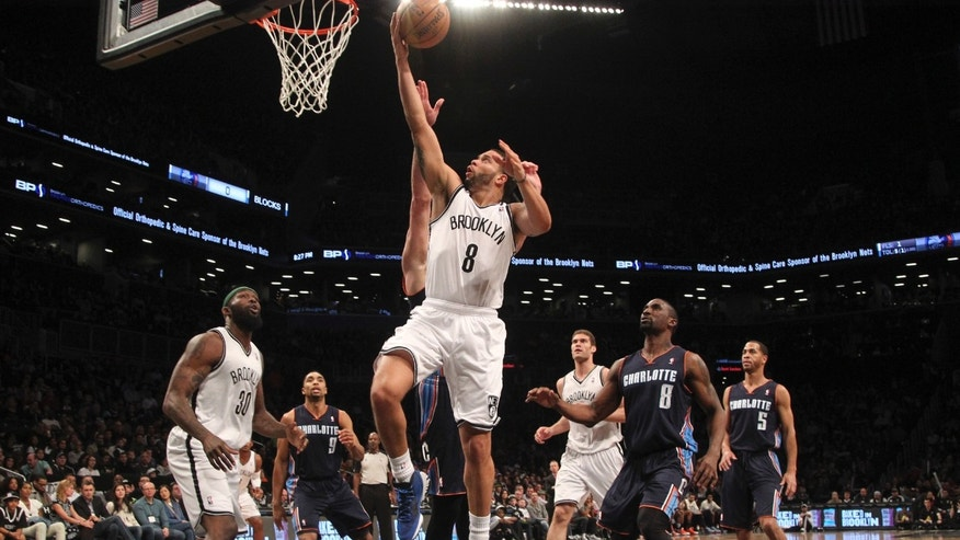 Brooklyn Nets' Deron Williams (8) scores during the first half of an NBA basketball game against the Charlotte Bobcats, Saturday, April 6, 2013, in New York. (AP Photo/Mary Altaffer)