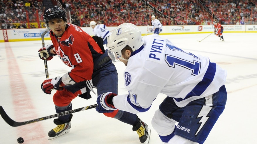 Washington Capitals left wing Alex Ovechkin (8), of Russia, pursues Tampa Bay Lightning center Tom Pyatt (11) during the first period of an NHL hockey game, Sunday, April 7, 2013, in Washington. (AP Photo/Nick Wass)