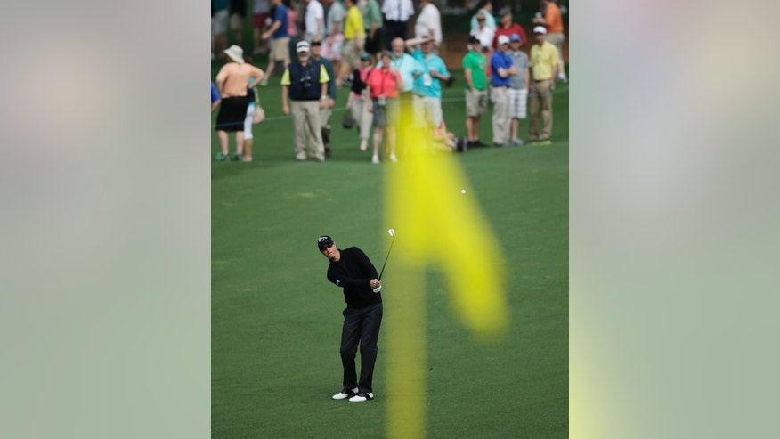 Nicolas Colsaerts, of Belgium, hits to the second green during a practice round for the Masters golf tournament Monday, April 8, 2013, in Augusta, Ga. (AP Photo/Matt Slocum)