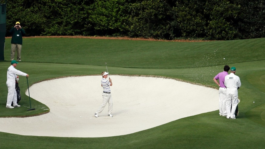 Russell Henley watches his chip shot on the fourth hole during a practice round for the Masters golf tournament Monday, April 8, 2013, in Augusta, Ga. (AP Photo/Charlie Riedel)