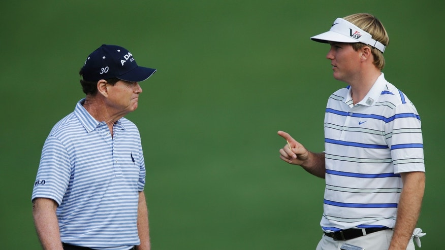 Russell Henley, right, speaks with Tom Watson at the second hole during a practice round for the Masters golf tournament Monday, April 8, 2013, in Augusta, Ga. (AP Photo/Matt Slocum)