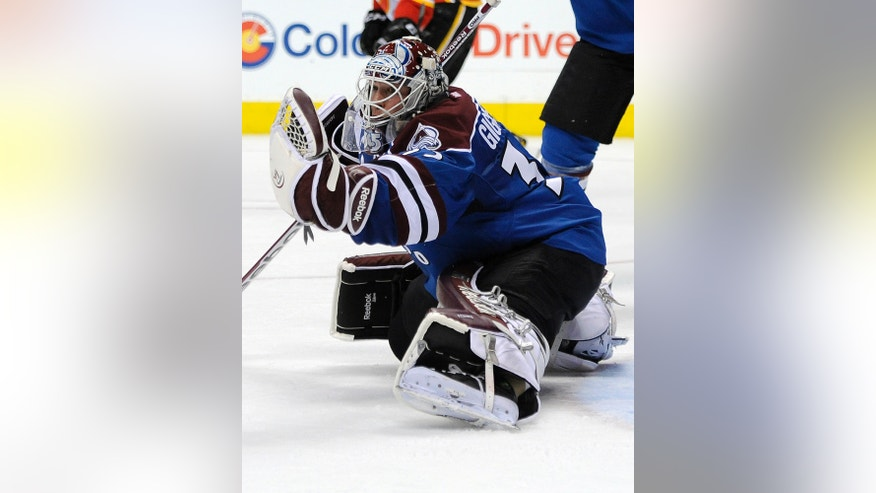 Colorado Avalanche goalie Jean-Sebastien Giguere makes a save in the first period of an NHL hockey game against the Calgary Flames on Monday, April 8, 2013, in Denver. (AP Photo/Chris Schneider)