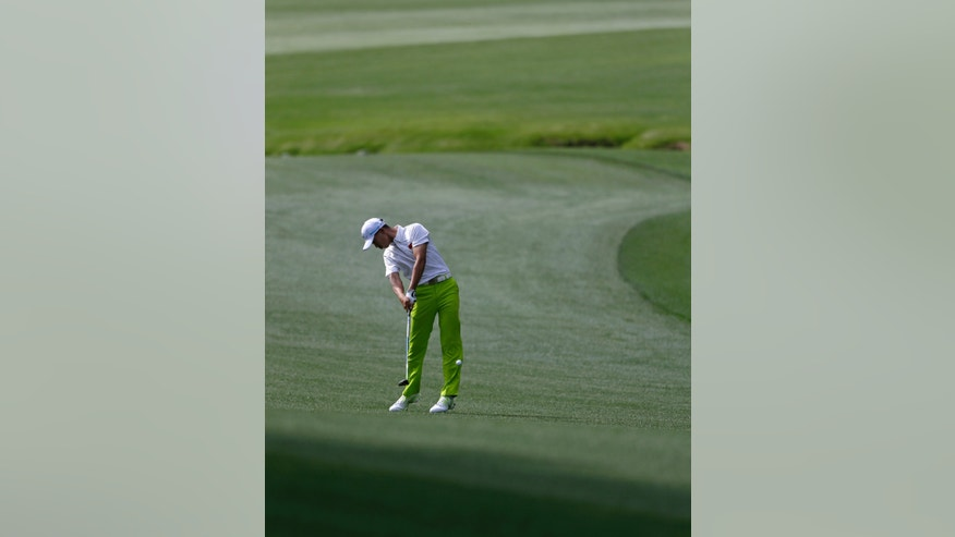 Amateur Tianlang Guan, of China, hits off the 13th fairway during a practice round for the Masters golf tournament Monday, April 8, 2013, in Augusta, Ga. (AP Photo/David Goldman)