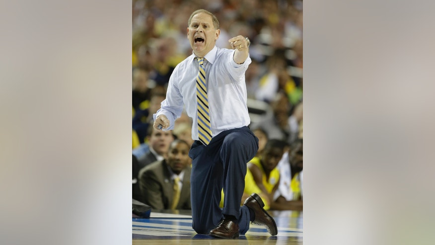Michigan head coach John Beilein speaks to players against Syracuse during the first half of the NCAA Final Four tournament college basketball semifinal game Saturday, April 6, 2013, in Atlanta. (AP Photo/John Bazemore)