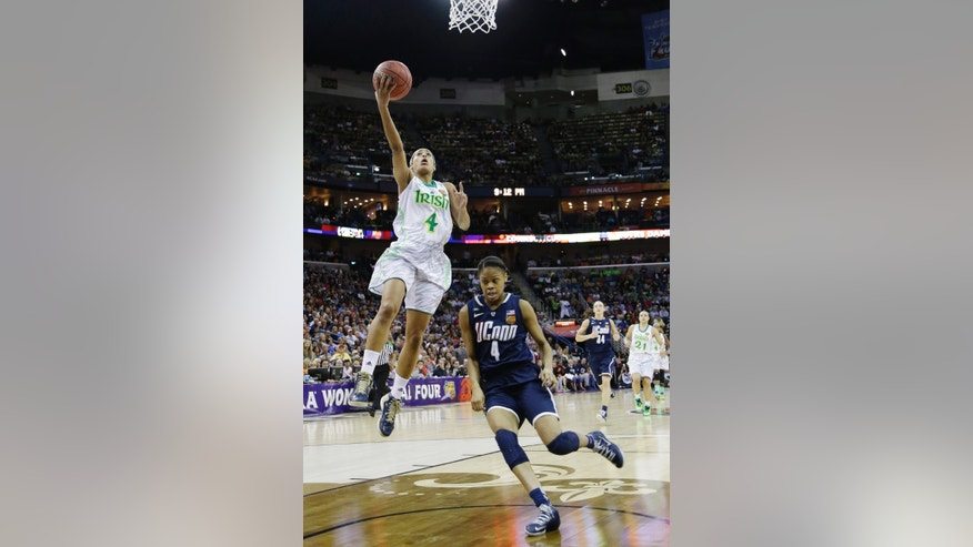 Notre Dame guard Skylar Diggins (4) goes up for a layup against Connecticut guard Moriah Jefferson (4) in the second half of the women's NCAA Final Four college basketball tournament semifinal, Sunday, April 7, 2013, in New Orleans. (AP Photo/Gerald Herbert)