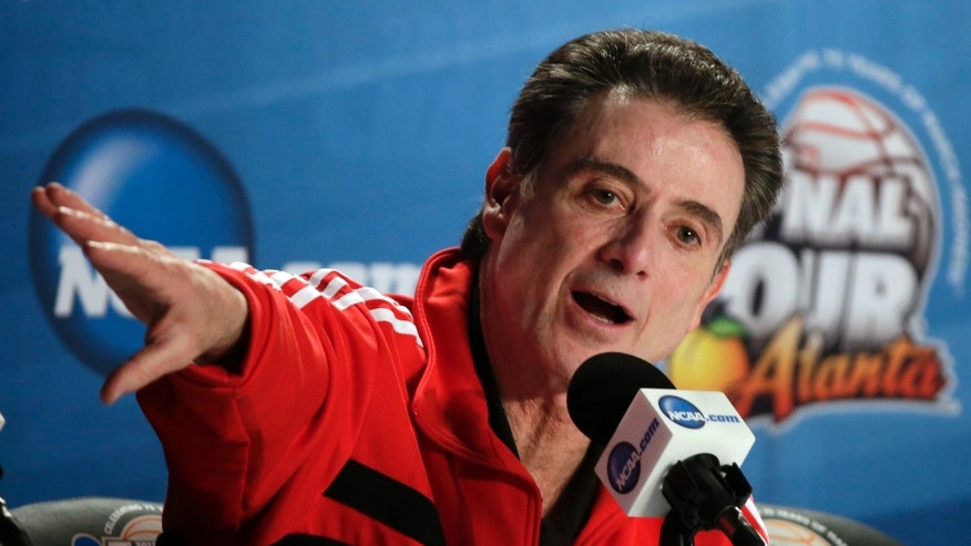 Louisville head coach Rick Pitino answers a question during a news conference for their NCAA Final Four tournament college basketball game Sunday, April 7, 2013, in Atlanta. Louisville plays Michigan in the championship game on Monday. (AP Photo/Chris O'Meara)