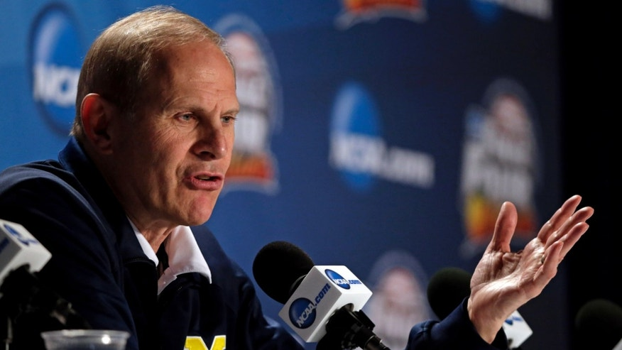 Michigan head coach John Beilein speaks during a news conference for their NCAA Final Four tournament college basketball game Sunday, April 7, 2013, in Atlanta. Michigan plays Louisville in the championship game on Monday. (AP Photo/Chris O'Meara)