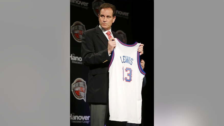 CBS announcer Jim Nantz holds a jersey for former Houston coach Guy Lewis during the Naismith Memorial Basketball Hall of Fame class announcement, Monday, April 8, 2013, in Atlanta, Georgia. Lewis was unable to attend the announcement. (AP Photo/Charlie Neibergall)