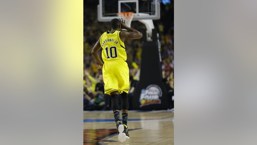 Michigan guard Tim Hardaway Jr. (10) reacts to a 3-point shot against the Louisville during the first half of the NCAA Final Four tournament college basketball championship game Monday, April 8, 2013, in Atlanta. (AP Photo/John Bazemore)