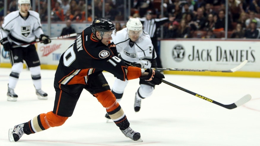 Anaheim Ducks' Corey Perry fires the puck to score a goal in the second period of an NHL hockey game against the Los Angeles Kings in Anaheim, Calif., on Sunday, April 7, 2013. The Ducks won 4-3. (AP Photo/Christine Cotter)