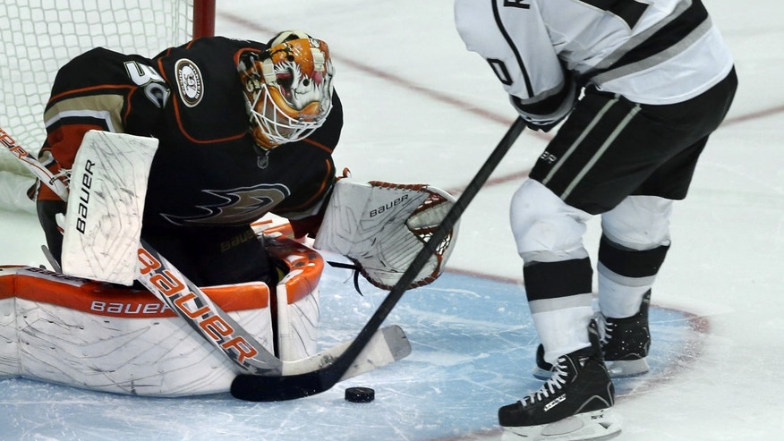 Anaheim Ducks goalie Viktor Fasth stops a puck off  Los Angeles Kings' Mike Richards a shootout in an NHL hockey game in Anaheim, Calif., on Sunday, April 7, 2013. The Ducks won 4-3. (AP Photo/Christine Cotter)