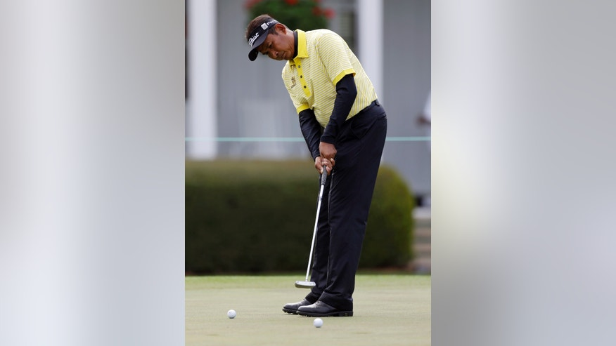 Thaworn Wiratchant , of Thailand, putts on the practice green during a practice round for the Masters golf tournament Monday, April 8, 2013, in Augusta, Ga. (AP Photo/David Goldman)