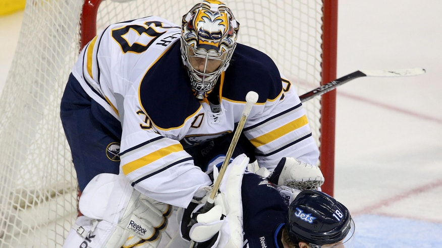 Buffalo Sabres goaltender Ryan Miller (30) stops Winnipeg Jets' Bryan Little (18) during the third period of their NHL hockey game in Winnipeg, Manitoba, Tuesday, April 9, 2013. The Jets won 4-1. (AP Photo/The Canadian Press, Trevor Hagan)
